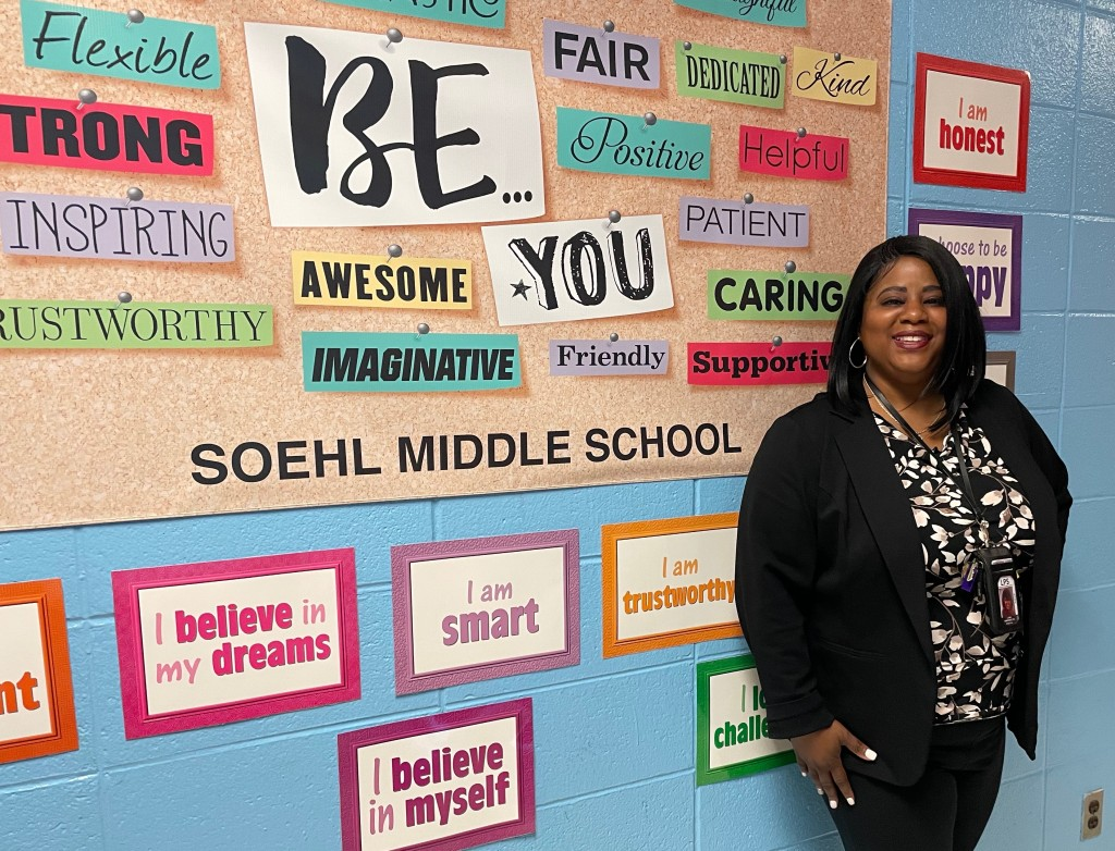 principal in front of wall display